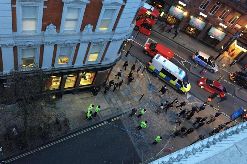 Police cordon: Nearby offices and shops were evacuated (Nick Edell)