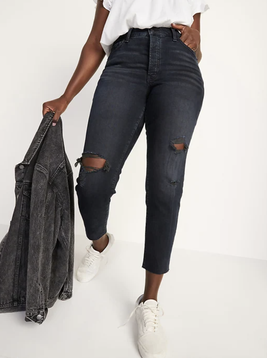 plus size model wearing white sneakers and black High-Waisted O.G. Straight Button-Fly Cut-Off Jeans