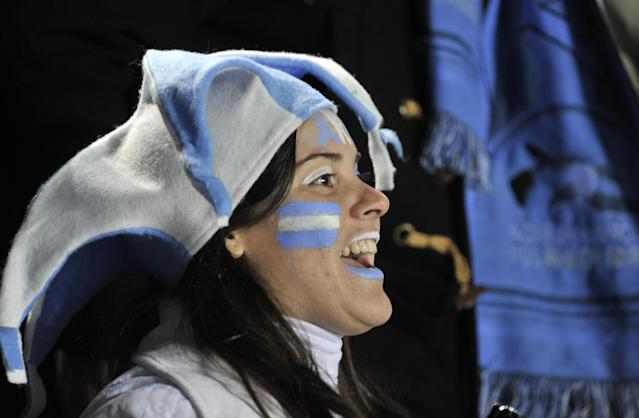 A supporter of Argentina cheers for her national team before the start of the 2011 Copa America Group A first round football match against Colombia, at the Cementerio de Elefantes stadium in Santa Fe, 476 Km north of Buenos Aires, on July 6, 2011. (Photo credit should read OMAR TORRES/AFP/Getty Images)