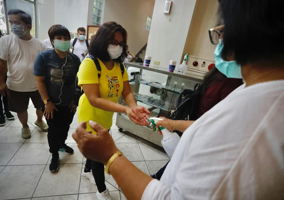 Catholics go through containment protocols including body-temperature measurement and hands-sanitisation before entering the Saint Christopher Parish Church, Taipei City, Taiwan, 26 July 2020. Complying with health advices from the government to stem the spread of the coronavirus Covid-19, staff members of the church also set out the limited number of people allowed to enter the premises to 80 for each session in order to minimise contacts between the believers. (Photo by Ceng Shou Yi/NurPhoto via Getty Images)