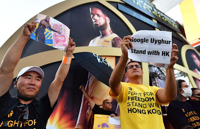 """Pro-Hong Kong activists protested <a class=""""link rapid-noclick-resp"""" href=""""/nba/players/3704/"""" data-ylk=""""slk:LeBron James"""">LeBron James</a> outside Staples Center ahead of the NBA season opener. (Frederic J. Brown/AFP via Getty Images)"""