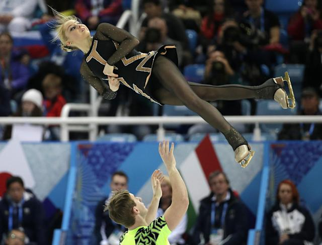 Julia Lavrentieva and Yuri Rudyk of Ukraine compete in the team pairs short program figure skating competition at the Iceberg Skating Palace during the 2014 Winter Olympics, Thursday, Feb. 6, 2014, in Sochi, Russia. (AP Photo/Bernat Armangue)