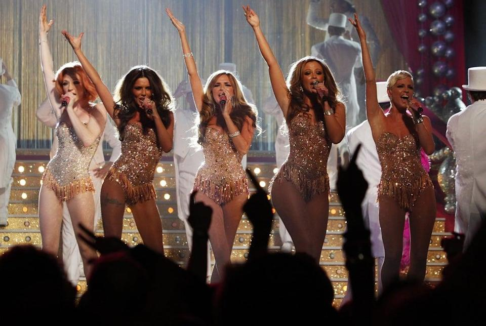Girls Aloud performing on stage at the Brit Awards (Yui Mok/PA) (PA Archive)