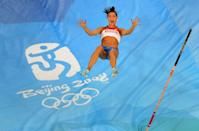 Elena Isinbaeva of Russia celebrates successfully jumping a new World Record of 5.05 in the Women's Pole Vault Final at the National Stadium on Day 10 of the Beijing 2008 Olympic Games on August 18, 2008 in Beijing, China. (Photo by Harry How/Getty Images)