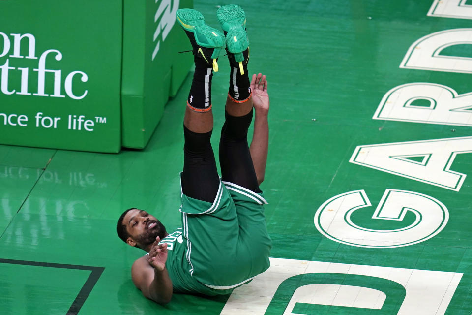 Boston Celtics center Tristan Thompson (13) is upended after block by New York Knicks center Nerlens Noel during the first half of an NBA basketball game Wednesday, April 7, 2021, in Boston. (AP Photo/Charles Krupa)