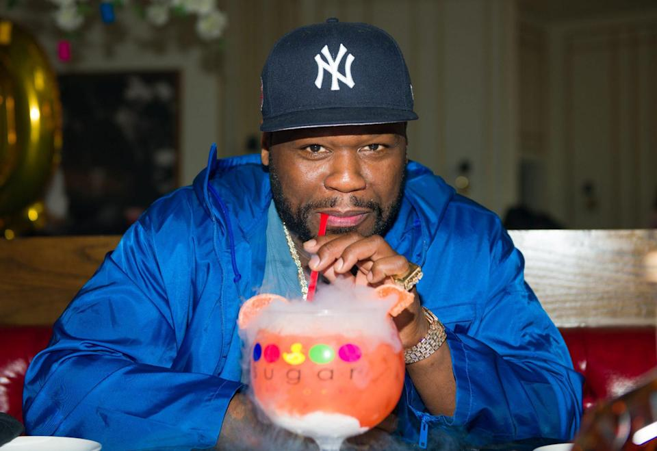 <p>50 Cent sips a sweet drink on Sunday during a visit to Sugar Factory Atlanta.</p>