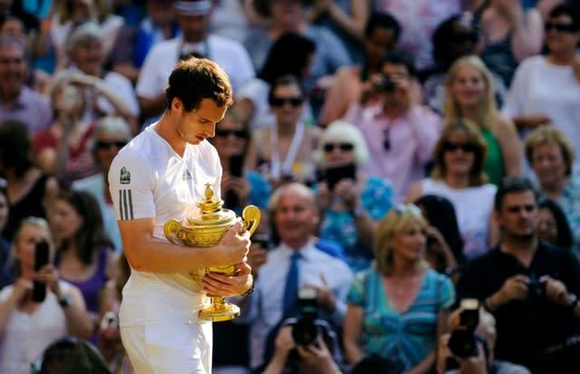 Andy Murray cradles the Wimbledon trophy following a historic Centre Court win in 2013. The 26-year-old Scot became Britain's first Wimbledon men's singles champion since Fred Perry in 1936 when he defeated world number one Novak Djokovic 6-4 7-5 6-4. Murray again won the tournament in 2016 (Dominic Lipinski/PA)