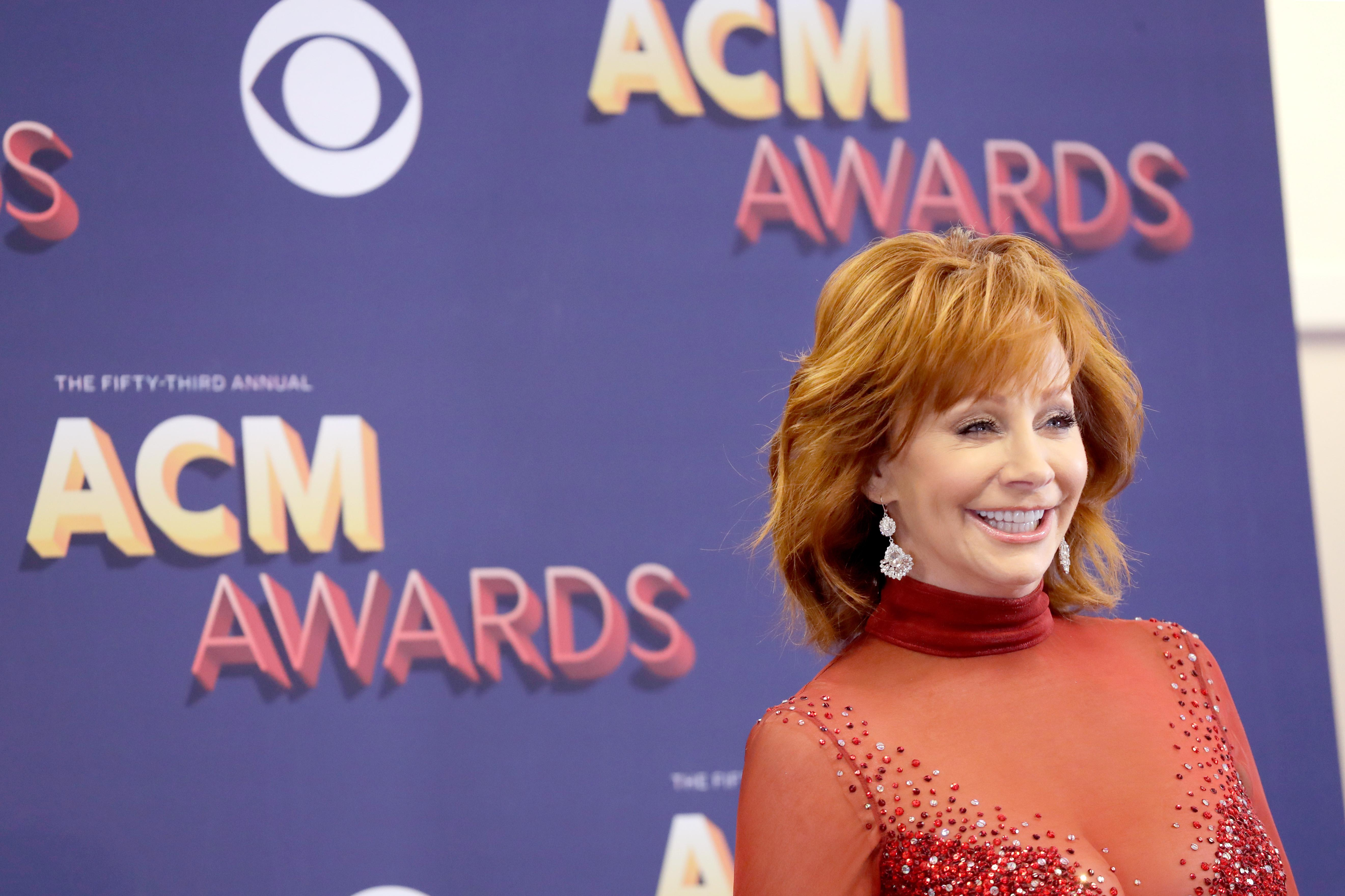 Reba McEntire brings back infamous red dress 25 years later