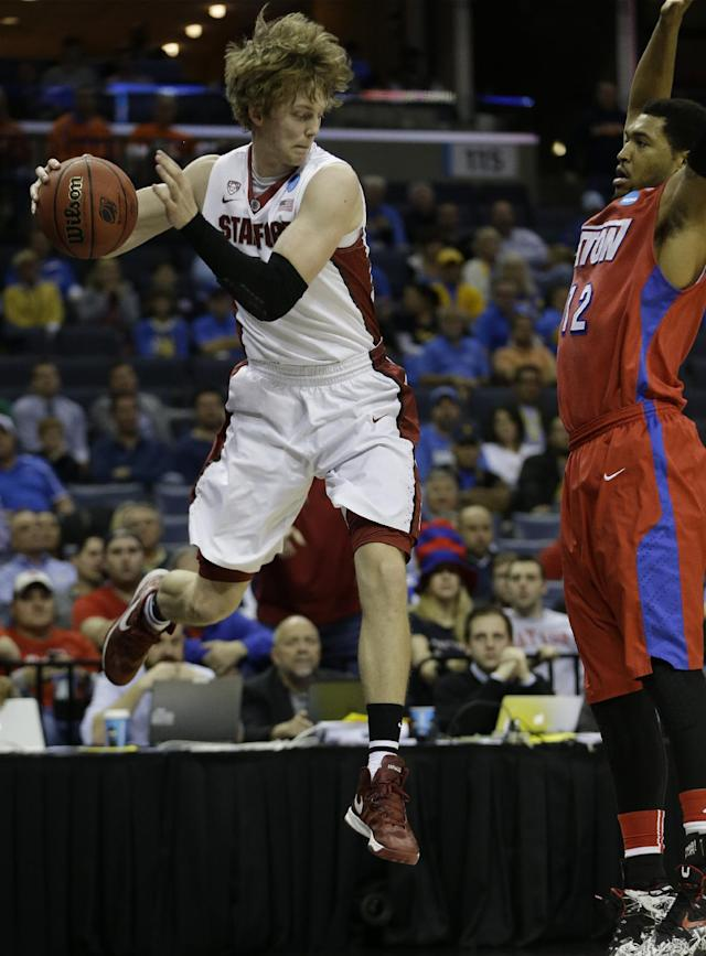 Stanford's John Gage (40) prepares to the throw the ball at Dayton's Jalen Robinson (12) during the first half in a regional semifinal game at the NCAA college basketball tournament, Thursday, March 27, 2014, in Memphis, Tenn. (AP Photo/Mark Humphrey)