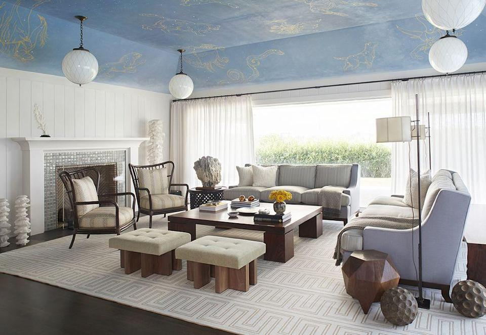 """<p>Blue skies brighten the world. By painting the ceiling a light blue, designer Rodney Lawrence created an optical illusion that opens up this <a href=""""https://www.elledecor.com/design-decorate/house-interiors/a32906036/rodney-lawrence-quogue-beach-house/"""" rel=""""nofollow noopener"""" target=""""_blank"""" data-ylk=""""slk:Quogue, New York,"""" class=""""link rapid-noclick-resp"""">Quogue, New York,</a> living room. </p>"""