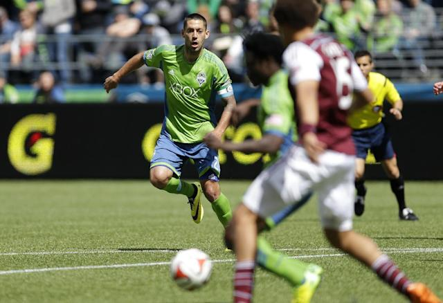 Seattle Sounders' Clint Dempsey, left, eyes the ball during the second half of an MLS soccer match against the Colorado Rapids, Saturday, April 26, 2014, in Seattle. The Sounders defeated the Rapids, 4-1. (AP Photo/Ted S. Warren)