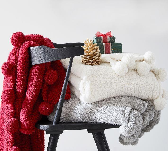 "<p>potterybarn.com</p><p><strong>$49.00</strong></p><p><a href=""https://go.redirectingat.com?id=74968X1596630&url=https%3A%2F%2Fwww.potterybarn.com%2Fproducts%2Fcozy-pom-pom-throw%2F&sref=https%3A%2F%2Fwww.housebeautiful.com%2Fshopping%2Fg34426352%2Fpottery-barn-christmas-collection-2020%2F"" rel=""nofollow noopener"" target=""_blank"" data-ylk=""slk:BUY NOW"" class=""link rapid-noclick-resp"">BUY NOW </a></p><p>These super soft sherpa throws feature fun </p>"