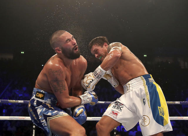 Tony Bellew (L) reacts to a blow from Oleksandr Usyk during their cruiserweight bout Nov. 10, 2018, in Manchester, England. Usyk successfully defended his four belts and likely sent Bellew into retirement by knocking out the British fighter in the eighth round. (Nick Potts/PA via AP)