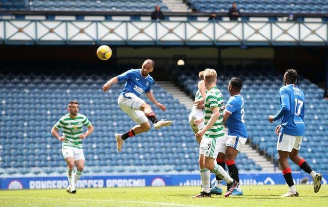 Rangers' Kemar Roofe scores his side's third goal in a 4-1 win against Celtic