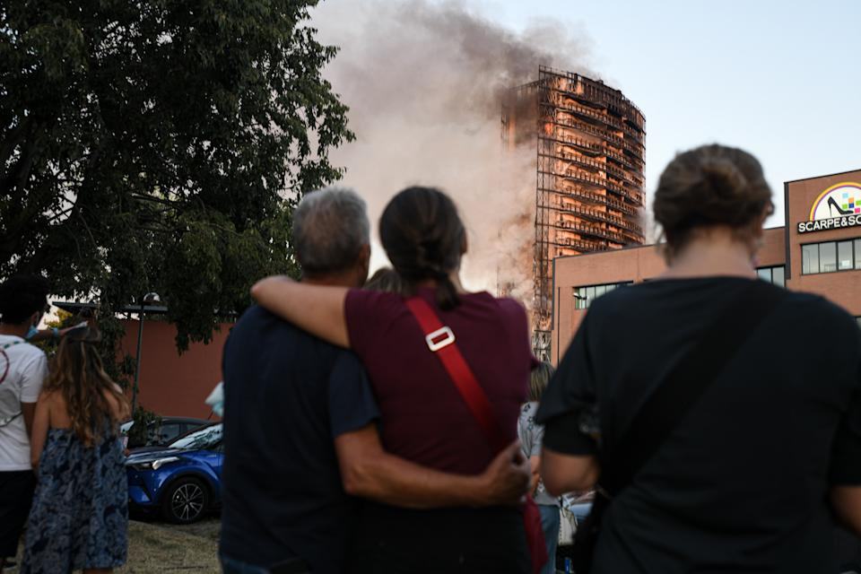 Locals watch on as the inferno is put out by authorities. Source: Getty