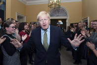 FILE - In this Friday Dec. 13, 2019 file photo Britain's Prime Minister Boris Johnson is greeted by staff as he returns to 10 Downing Street, London, after meeting Queen Elizabeth II at Buckingham Palace and accepting her invitation to form a new government. Britain and the European Union have struck a provisional free-trade agreement that should avert New Year's chaos for cross-border commerce and bring a measure of certainty to businesses after years of Brexit turmoil. The breakthrough on Thursday, Dec. 24, 2020 came after months of tense and often testy negotiations that whittled differences down to three key issues: fair-competition rules, mechanisms for resolving future disputes and fishing rights. (Stefan Rousseau/PA via AP, File)