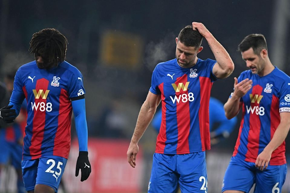 <p>Crystal Palace's Eberechi Eze, Gary Cahill and Scott Dann look dejected after defeat at Selhurst Park</p> (POOL/AFP via Getty Images)