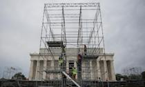 Construction workers climb scaffolding being put up as part of a stage to be used in the presidential inauguration festivities for incoming US President-elect Donald Trump (AFP Photo/Andrew CABALLERO-REYNOLDS)