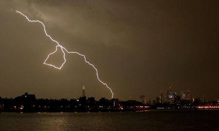 General view as lightning strikes over the city of London, Britain May 26, 2018. REUTERS/Tom Jacobs