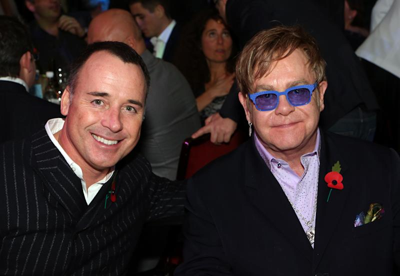 David Furnish, left, and Elton John are seen at the 2012 Music Industry Trusts Award ceremony at the Grosvenor House Hotel on Monday, Nov. 5, 2012, in London. (Photo by John Marshall JM Enternational/Invision/AP)
