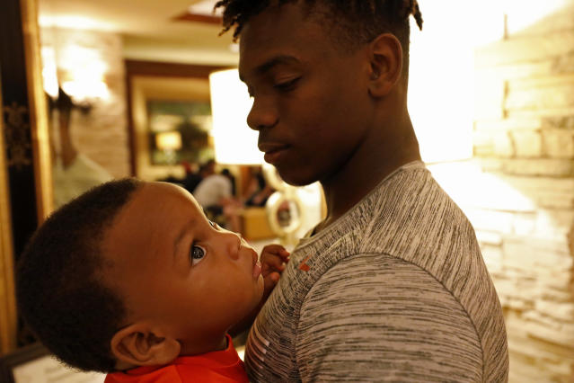 Texas Longhorns' Anthony Cook holds his little brother Dash McKinney Friday Sept. 6, 2019 at the team hotel in Austin, Tx. ( Photo by Edward A. Ornelas )