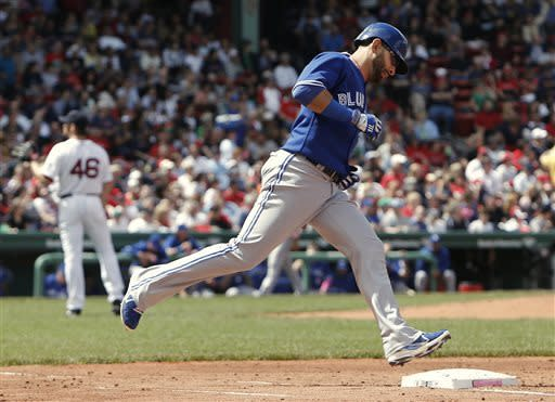 Toronto Blue Jays' Jose Bautista rounds the bases after his home run off of Boston Red Sox starting pitcher Ryan Dempster (46) during the third inning of an American League MLB baseball game at Fenway Park in Boston Sunday, May 12, 2013. (AP Photo/Winslow Townson)