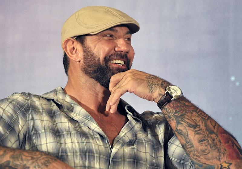 "Dave Bautista stands at 6'4"" (1.93 meters) and his enormous biceps are liberally tattooed (AFP Photo/Fyrol Mohd)"