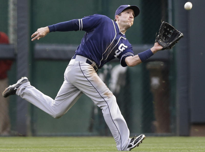 San Diego Padres right fielder Chris Denorfia catches a fly ball hit by Cincinnati Reds' Brandon Phillips in the fifth inning of the second baseball game of a doubleheader, Thursday, May 15, 2014, in Cincinnati. (AP Photo/Al Behrman)