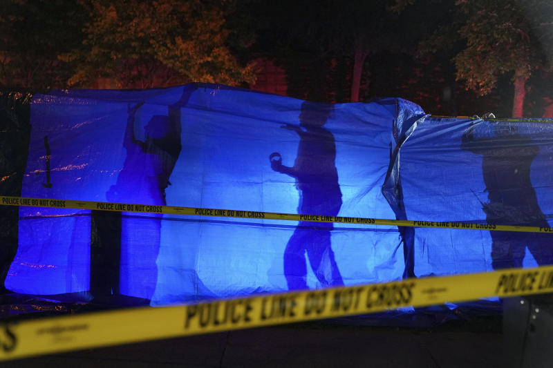 Police put up a blue tarp to block the view of a body at the scene of an officer involved shooting  in Richfield, Minn., Saturday night, Sept. 7, 2019. Police near Minneapolis shot and killed a driver following a chase after he apparently emerged from his car holding a knife and refused their commands to drop it. The chase started late Saturday night in Edina and ended in Richfield with officers shooting the man, Brian J. Quinones, who had streamed himself live on Facebook during the chase. (Anthony Souffle/Star Tribune via AP)