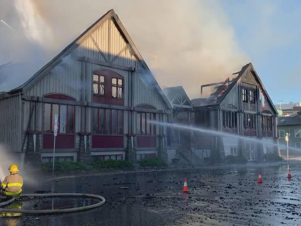 Firefighters in Prince George put out a fire at a commercial building at 611 Brunswick Street on Sunday. (Catherine Hansen/CBC News - image credit)