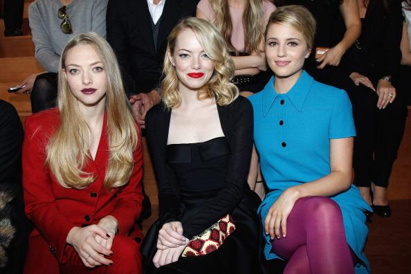 PARIS, FRANCE - OCTOBER 03:  Amanda Seyfried, Emma Stone and Dianna Agron attend the Miu Miu Spring/Summer 2013 show as part of Paris Fashion Week on October 3, 2012 in Paris, France.  (Photo by Bertrand Rindoff Petroff/Getty Images)