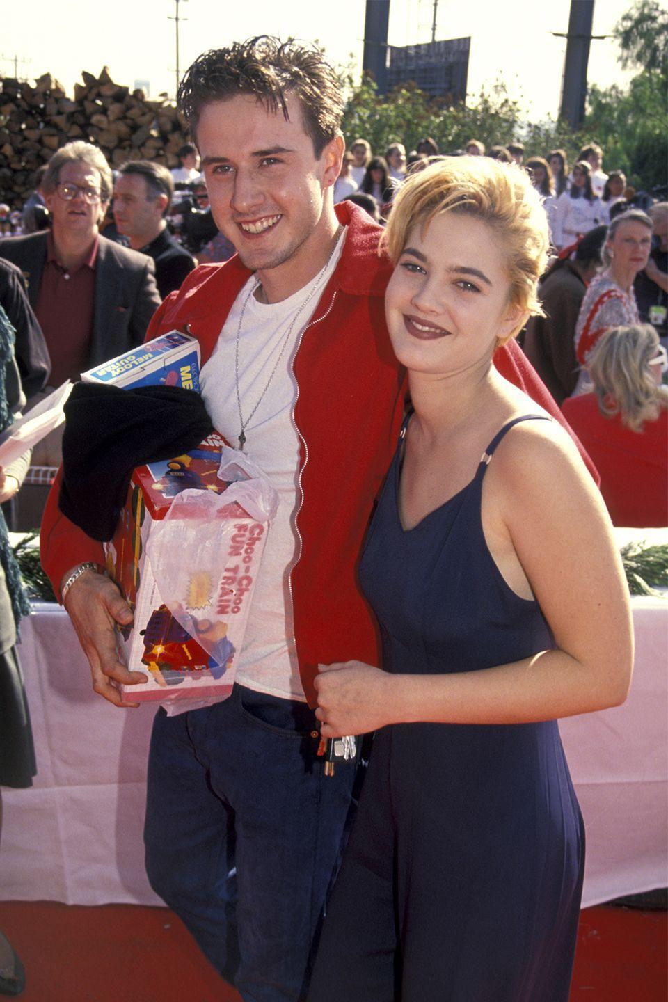 """<p>The <em>Never Been Kissed </em>brother and sister co-stars had a very different relationship off-camera. Though Barrymore denies it, Arquette said they used to date—long before they starred in the movie together. """"We also dated, but she denied it on Howard Stern,"""" <a href=""""http://ew.com/tv/2018/03/15/david-arquette-says-he-dated-drew-barrymore/"""" rel=""""nofollow noopener"""" target=""""_blank"""" data-ylk=""""slk:Arquette said"""" class=""""link rapid-noclick-resp"""">Arquette said</a> in an episode of<em> PeopleTV</em>'s <em>Couch Surfing</em>. """"But, we dated, Drew!""""</p>"""