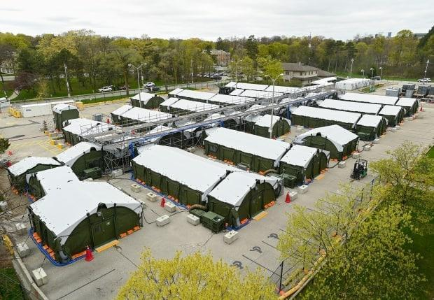 A mobile health unit is shown on the grounds of Sunnybrook Hospital during the COVID-19 pandemic in Toronto on April 30, 2021.