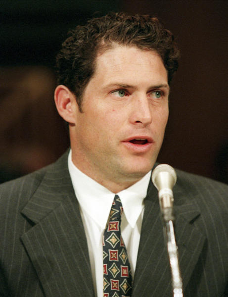 FILE - In this March 19, 1997, file photo, then-San Francisco 49ers quarterback Steve Young, founder of the Sport, Education and Values Foundation, testifies on Capitol Hill. Young will be one of the keynote speakers at a three-day conference, beginning Friday Sept. 13, 2013, in Salt Lake City exploring how the Mormon faith is dealing with gays and lesbians. (AP Photo/Joe Marquette, file)