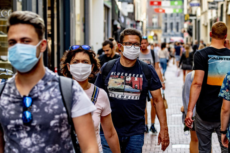 AMSTERDAM, NETHERLANDS - 2020/08/04: People are seen wearing facemasks as a mandatory measure against Covid-19 on the busy calf street in Amsterdam. As of 5th August, wearing of face masks is going to be mandatory in busy places in Amsterdam such as malls, shopping streets, public transport and all public places following the recent concerns about a wide return of coronavirus in the Netherlands. (Photo by Robin Utrecht/SOPA Images/LightRocket via Getty Images)