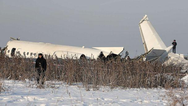 PHOTO: Emergency and security personnel are seen at the site of a plane crash near Almaty, Kazakhstan, December 27, 2019. (Pavel Mikheyev/Reuters)