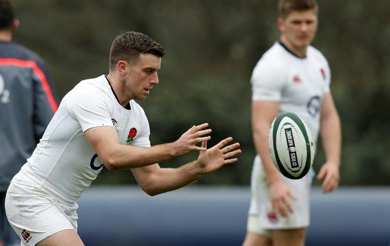 England's centre Owen Farrell (R) watches fly-half George Ford during a team training session at Pennyhill Park in Bagshot, on March 16, 2017
