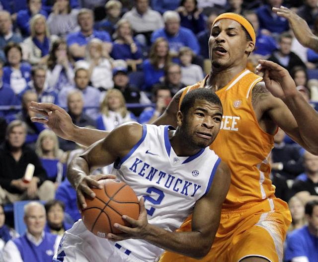 Kentucky's Aaron Harrison (2) looks for an opening against Tennessee's Jarnell Stokes (5) during the second half of an NCAA college basketball game, Saturday, Jan. 18, 2014, in Lexington, Ky. Kentucky won 74-66. (AP Photo/James Crisp)