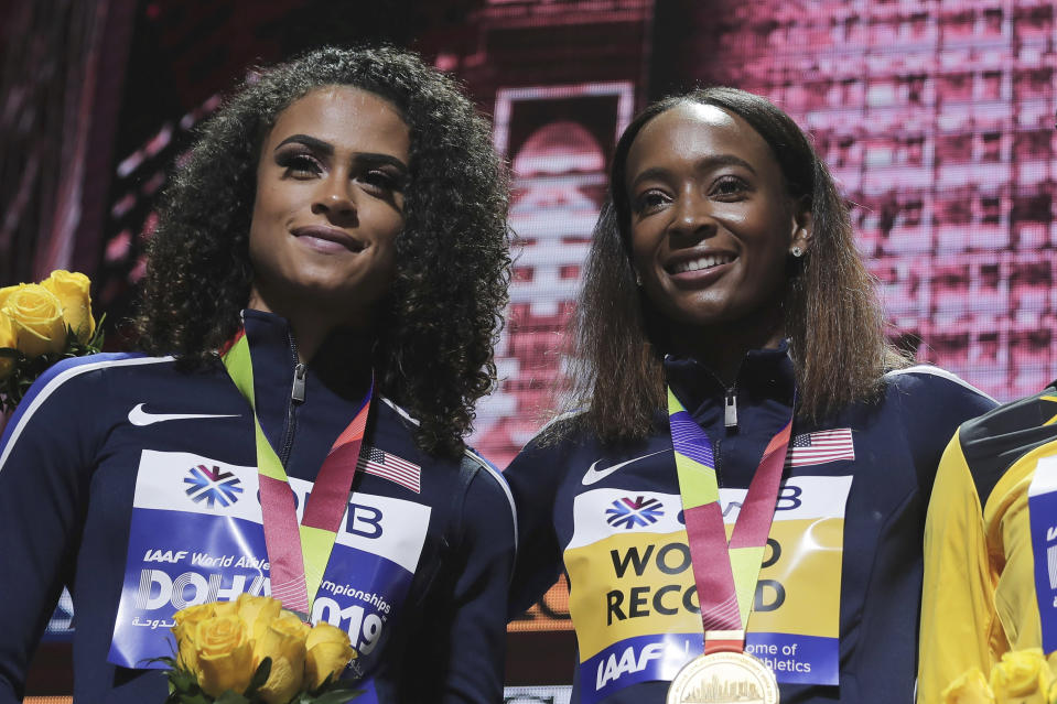 FILE - Silver medalist Sydney McLaughlin, left, and gold medalist Dalilah Muhammad, both from the United States, pose during the medal ceremony for the women's 400m hurdles at the World Athletics Championships in Doha, Qatar, in this Saturday, Oct. 5, 2019, file photo. The most anticipated race of the U.S. track and field trials may be the women's 400 hurdles, where world record holder Dalilah Muhammad tries to hold off the up-and-comer Sydney McLaughlin. (AP Photo/Nariman El-Mofty, File)