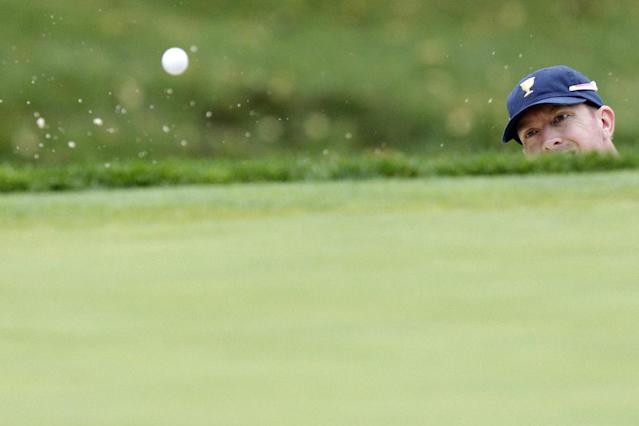 United States team player Hunter Mahan hits out of a bunker on the second hole during the single matches at the Presidents Cup golf tournament at Muirfield Village Golf Club Sunday, Oct. 6, 2013, in Dublin, Ohio. (AP Photo/Jay LaPrete)