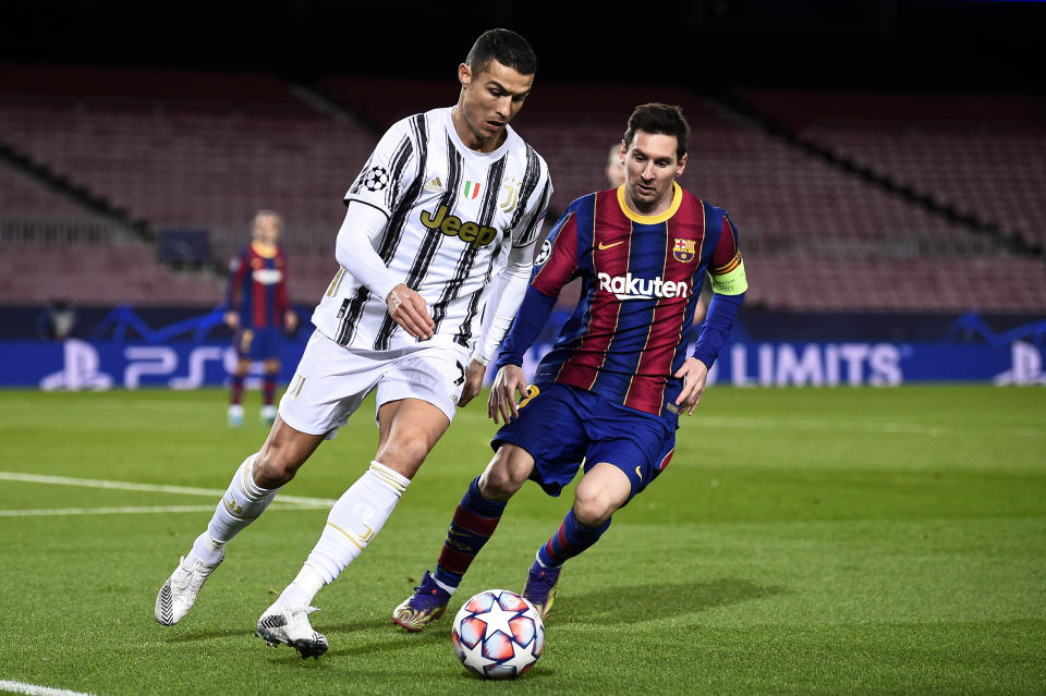 CAMP NOU, BARCELONA, SPAIN - 2020/12/08: Cristiano Ronaldo (L) of Juventus FC is challenged by Lionel Messi of FC Barcelona during the UEFA Champions League Group G football match between FC Barcelona and Juventus. Juventus FC won 3-0 over FC Barcelona. (Photo by Nicolò Campo/LightRocket via Getty Images)