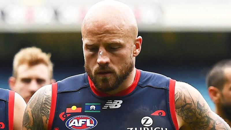 Nathan Jones, pictured leaving the MCG after a loss, is the first player ever to lose 100 games at one ground.