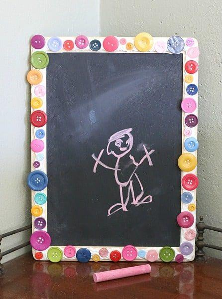"""<p>If you need a place for little notes, reminders and words of encouragement, this DIY chalkboard is it. Plus, you get to use up all the extra buttons you have lying around the house.</p><p><em><a href=""""https://buggyandbuddy.com/make-mini-chalkboard-kids/"""" rel=""""nofollow noopener"""" target=""""_blank"""" data-ylk=""""slk:Get the tutorial at Buggy and Buddy »"""" class=""""link rapid-noclick-resp"""">Get the tutorial at Buggy and Buddy »</a></em></p>"""