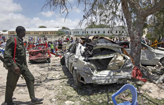 <p>A Somali soldier walks near the wreckage of vehicles at the scene of a blast outside the compound of a district headquarters in the capital Mogadishu, Somalia Sunday, September 2, 2018. (AP Photo/Farah Abdi Warsameh) </p>