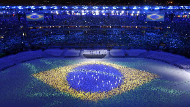 <p>The Brazilian flag is seen projected during the closing ceremony of the 2016 Rio Olympics on August 21, 2016. (REUTERS/Fabrizio Bensch) </p>