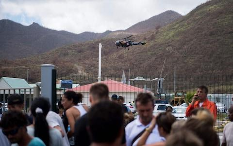 A helicopter of French army brings food to the Grand-Case Esperance airport, on Saint-Martin island - Credit: AFP