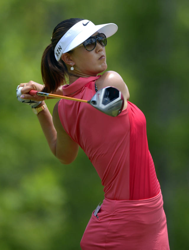 Michelle Wie hits her tee shot on the fourth hole in the final round of the Airbus LPGA Classic golf tournament at Magnolia Grove on Sunday, May 25, 2014, in Mobile, Ala. (AP Photo/G.M. Andrews)