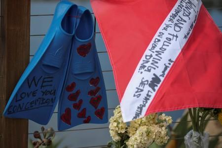 A diving flag and fins hang on a makeshift memorial near Truth Aquatics as the search continues for those missing in a pre-dawn fire that sank a commercial diving boat off  Santa Barbara, California,