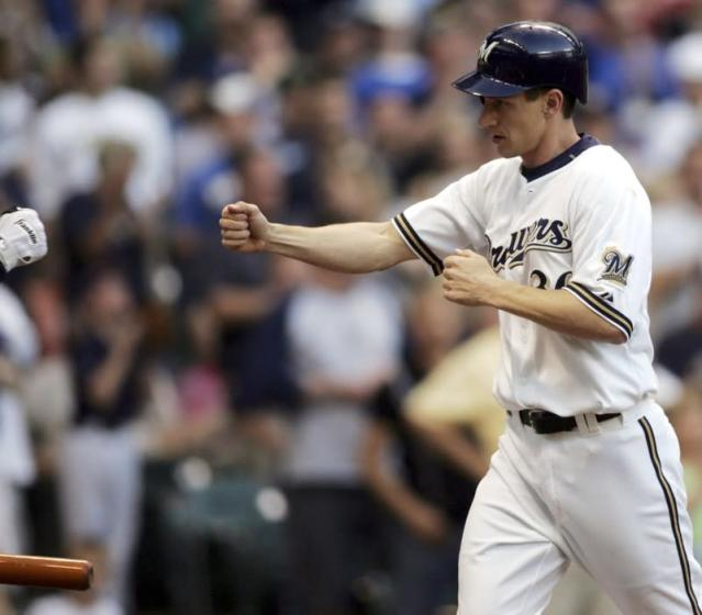 Milwaukee Brewers batter Craig Counsell is congratulated after his first home run of season in Milwaukee