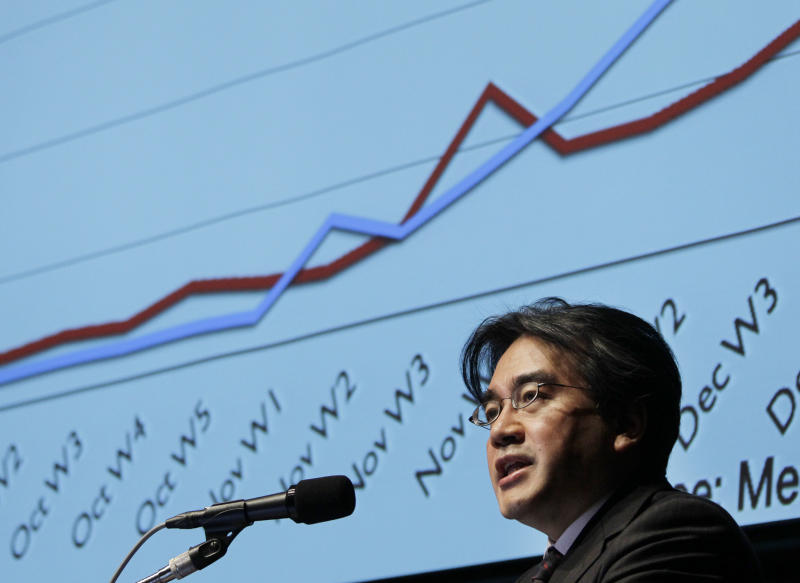 Nintendo Co. President Satoru Iwata speaks during the company's financial results briefing in Tokyo Friday, Jan. 28, 2011. Iwata said rival Sony was taking a different tack from his company and so he remains upbeat about his 3-D portable game machine going on sale next month. (AP Photo/Koji Sasahara)